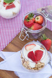 Delicious fresh strawberries and yoghurt breakfast. Fresh strawberries with yoghurt at breakfast Royalty Free Stock Images