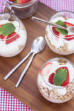 Delicious fresh strawberries and yoghurt breakfast. Fresh strawberries with yoghurt at breakfast Stock Image