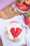 Delicious fresh strawberries and yoghurt breakfast. Fresh strawberries with yoghurt at breakfast Stock Images