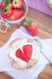Delicious fresh strawberries and yoghurt breakfast. Fresh strawberries with yoghurt at breakfast Royalty Free Stock Image
