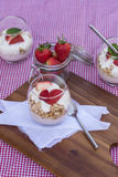 Delicious fresh strawberries and yoghurt breakfast. Fresh strawberries with yoghurt at breakfast Stock Photography
