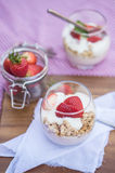 Delicious fresh strawberries and yoghurt breakfast. Fresh strawberries with yoghurt at breakfast Royalty Free Stock Photography
