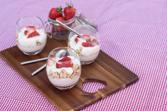 Delicious fresh strawberries and yoghurt breakfast. Fresh strawberries with yoghurt at breakfast Royalty Free Stock Photos