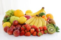Fresh fruits. Delicious and fresh variety fruits on white background royalty free stock photo