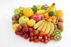 Fresh fruits. Delicious and fresh variety fruits on white background royalty free stock photos
