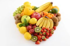 Fresh fruits. Delicious and fresh variety fruits on white background stock photography