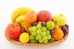 Fresh fruits. Delicious and fresh variety fruits on white background royalty free stock image