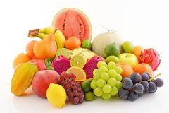 Fresh fruits. Delicious and fresh variety fruits on white background royalty free stock photography