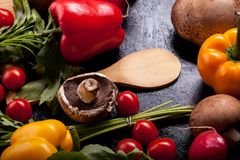 Delicious fresh vegetable on dark wooden background. In close up image Stock Images