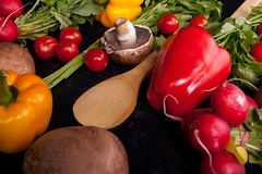 Delicious fresh vegetable on dark wooden background. In close up image Stock Photos