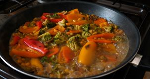 Delicious fresh vegetables are stewed in a pan, food for vegetarians at home. Concept of: Veg, Bio Product, Mushrooms, Broccoli, Colored Cabbage, Carrot, Corn stock video