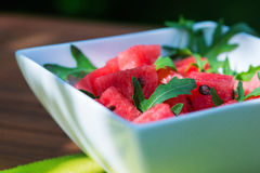 Delicious fresh watermelon and arugula salad Stock Photography