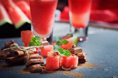 Delicious fresh watermelon cocktail, pieсes of chocolate and ci. Nnamon on the dark background Royalty Free Stock Images