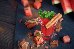 Delicious fresh watermelon cocktail, pieces of chocolate and ci Stock Photos