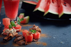 Delicious fresh watermelon cocktail, pieces of chocolate and ci. Nnamon on the dark background Royalty Free Stock Images