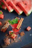 Delicious fresh watermelon cocktail, pieces of chocolate and cin. Namon on the dark background Stock Photo