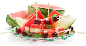 Delicious fresh watermelon and melon salad with cherries and min Royalty Free Stock Images
