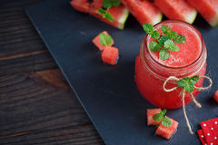 Delicious fresh watermelon smoothie. Delicious fresh watermelon smoothie on the dark wooden background. Healthy food concept Stock Photos