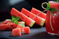 Delicious fresh watermelon smoothie. Delicious fresh watermelon smoothie on the dark wooden background. Healthy food concept Royalty Free Stock Photos