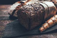 Delicious fresh bread on wooden background Royalty Free Stock Photography