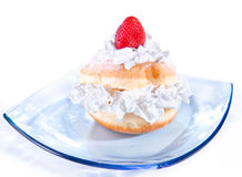 Delicious freshly baked donut with cream Stock Photos