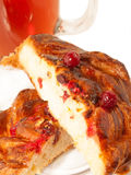 Delicious freshly baked pastry  with cranberries and cup of tea. Stock Photos