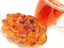 Delicious freshly baked pastry  with cranberries and cup of tea Royalty Free Stock Photo