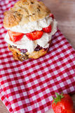 Delicious freshly baked scone filled with thick clotted cream Royalty Free Stock Photos