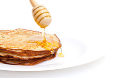 Delicious Freshly Prepared Pancakes with Honey. On white Royalty Free Stock Photography