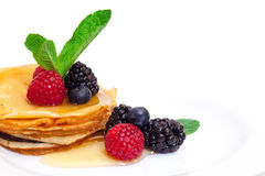 Delicious Freshly Prepared Pancakes with Honey and Berries. On white background stock photo