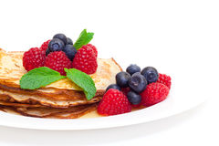 Delicious Freshly Prepared Pancakes with Honey and Berries. On white background stock image
