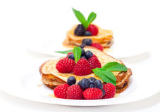 Delicious Freshly Prepared Pancakes with Honey and Berries. On white background royalty free stock photo