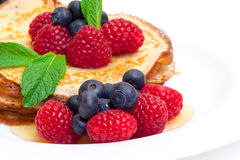 Delicious Freshly Prepared Pancakes with Honey and Berries. On white background royalty free stock images