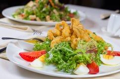 Delicious fried calamari appetizer Stock Photos