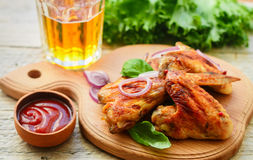 Delicious fried chicken wings with spices, red onion and ketchup Stock Photo
