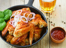Delicious fried chicken wings with spices, red onion and ketchup Royalty Free Stock Image