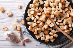Delicious fried croutons with garlic horizontal top view Royalty Free Stock Images