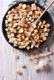 Delicious fried croutons with garlic vertical top view Royalty Free Stock Photography