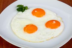 Delicious fried eggs royalty free stock images