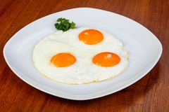 Delicious fried eggs stock images