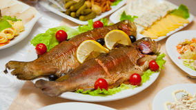 Delicious fried fish on table Stock Photos