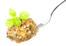 Delicious fried meat balls on fork with herbs  isolated on white Royalty Free Stock Photo