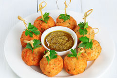 Delicious fried meatballs on wooden skewers Stock Image