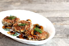 Delicious fried mushroom cutlets on a plate and wooden table. Healthy vegetarian cutlets. Mushroom dish. Homemade food photo Stock Photos