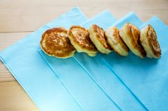 Delicious fried pancakes on a wooden table royalty free stock image