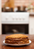 Delicious fried pancakes on wooden table Royalty Free Stock Photography