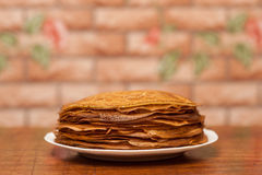 Delicious fried pancakes on wooden table Stock Photography