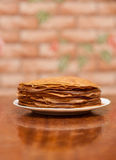 Delicious fried pancakes on wooden table Stock Images