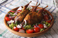 Delicious fried quail and fresh vegetables close-up. horizontal. Delicious fried quail and fresh vegetables close-up on a plate. horizontal Royalty Free Stock Photo