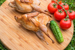 Delicious fried quail with vegetables Stock Photography